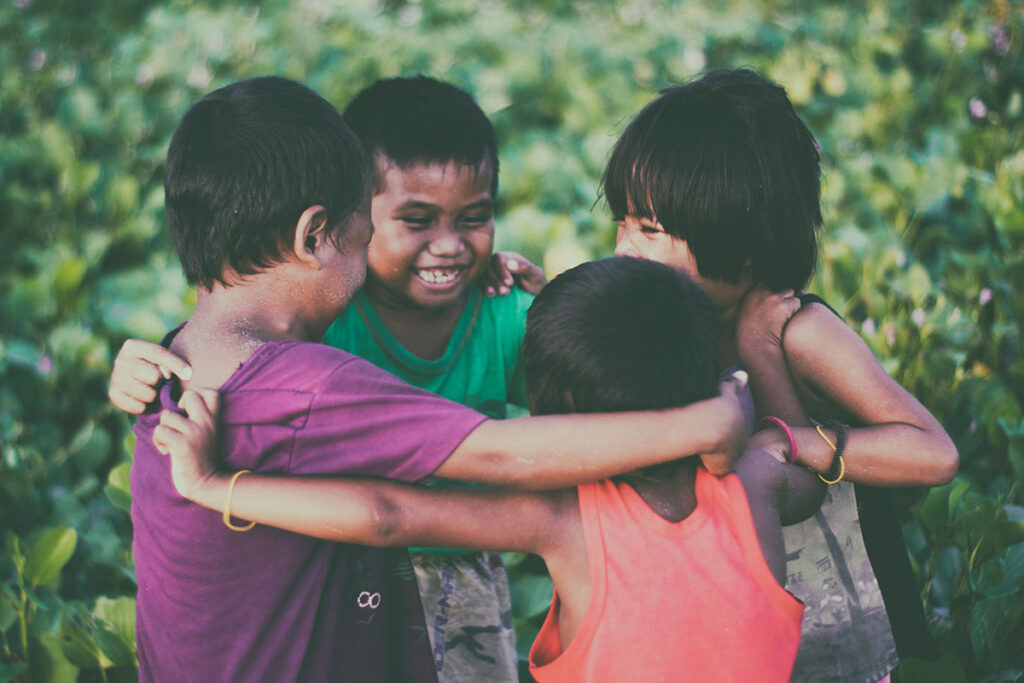 Children enjoying a group hug